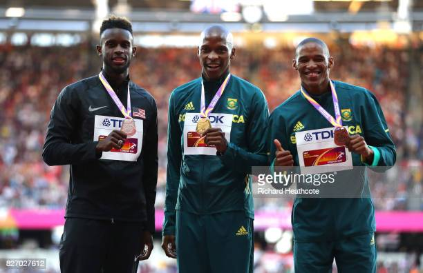 Jarrion Lawson of the United States Luvo Manyonga of South Africa gold and Ruswahl Samaai of South Africa bronze pose with their medals for the Men's...