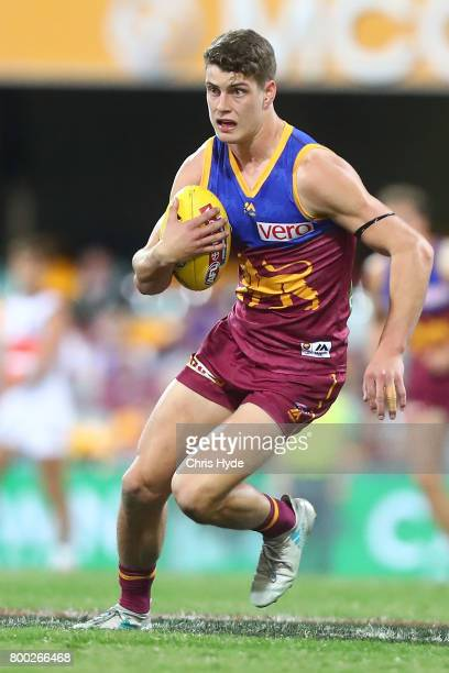 Jarrod Berry of the Lions runs the ball during the round 14 AFL match between the Brisbane Lions and the Greater Western Sydney Giants at The Gabba...