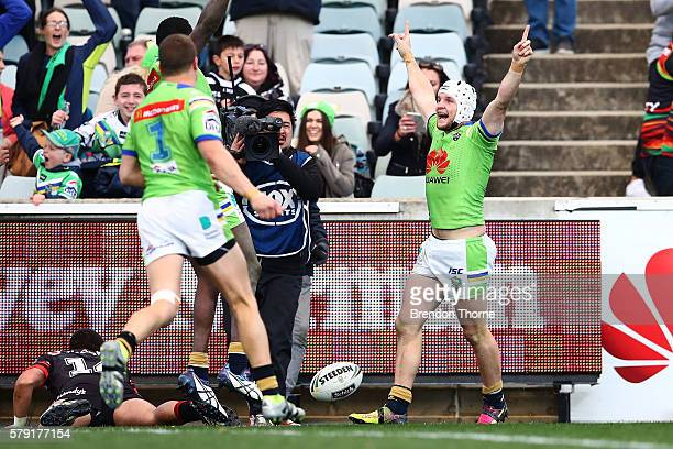 Jarrod Croker of the Raiders celebrates with team mates after scoring a try in golden point during the round 20 NRL match between the Canberra...