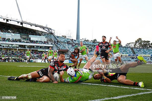 Jarrod Croker of the Raiders dives to score a try during the round 20 NRL match between the Canberra Raiders and the New Zealand Warriors at GIO...