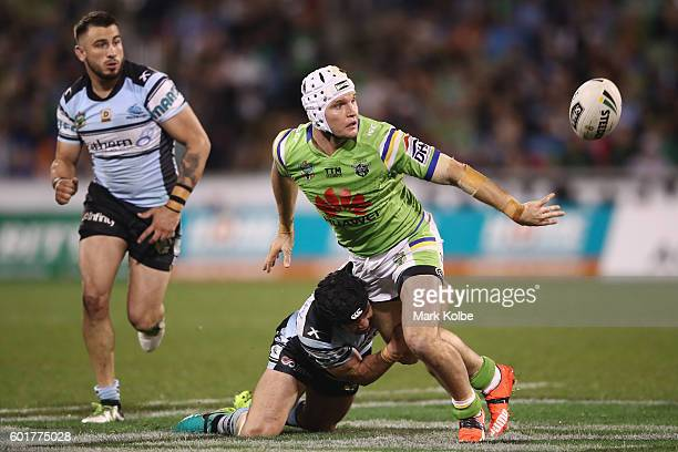 Jarrod Croker of the Raiders gets a pass away as he is tackled during the NRL Qualifying Final match between the Canberra Raiders and the Cronulla...