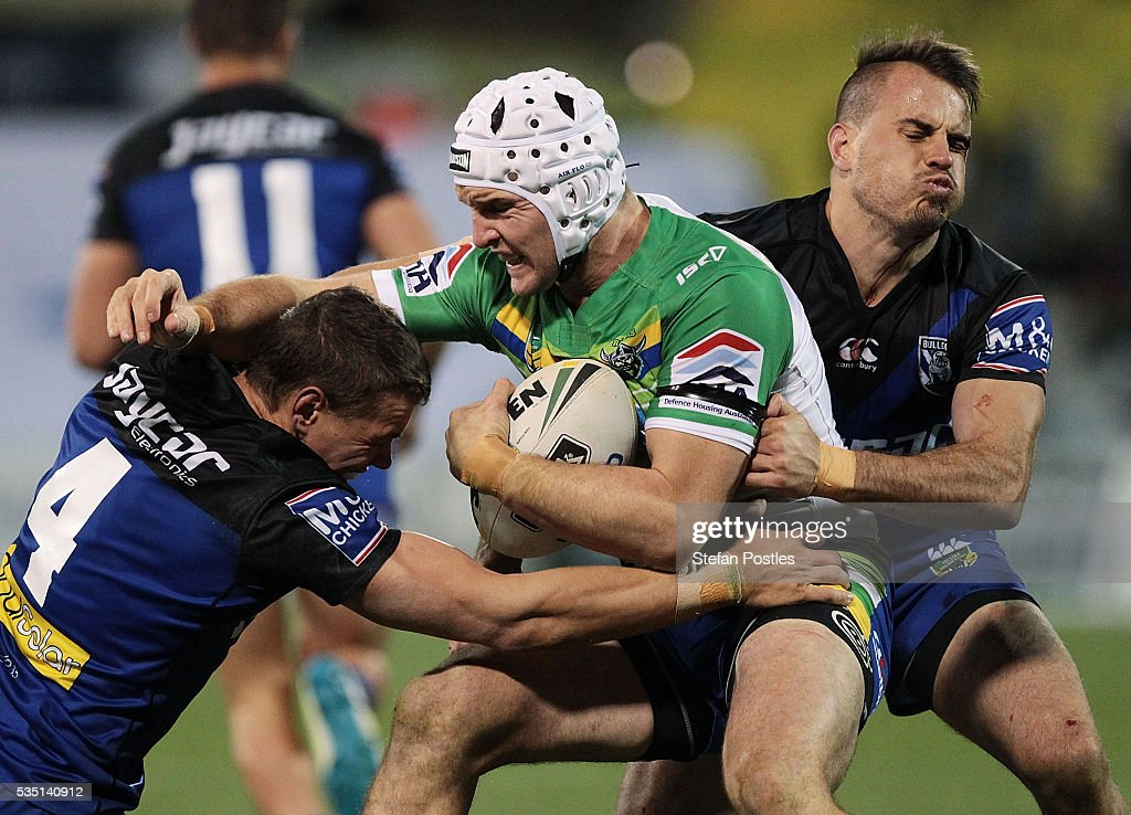 Jarrod Croker of the Raiders is tackled during the round 12 NRL match between the Canberra Raiders and the Canterbury Bulldogs at GIO Stadium on May 29, 2016 in Canberra, Australia.