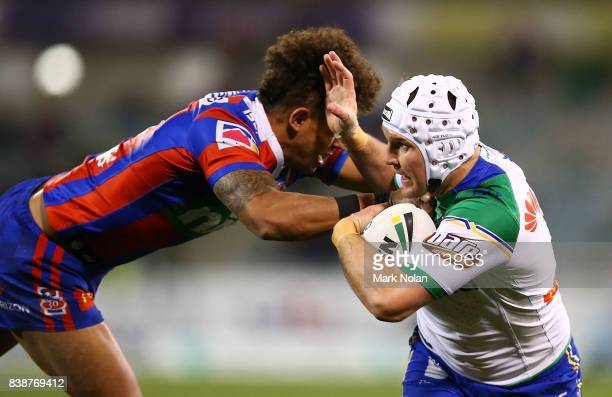 Jarrod Croker of the Raiders is tackled during the round 25 NRL match between the Canberra Raiders and the Newcastle Knights at GIO Stadium on August...