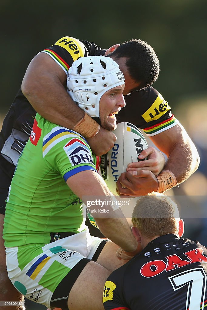 Jarrod Croker of the Raiders is tackled during the round nine NRL match between the Penrith Panthers and the Canberra Raiders at Carrington Park on April 30, 2016 in Bathurst, Australia.