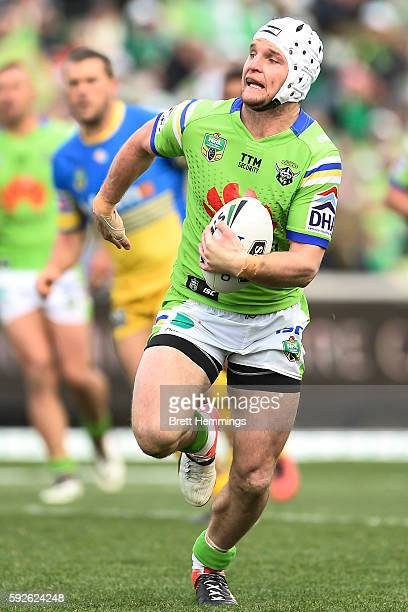 Jarrod Croker of the Raiders makes a break to score a try during the round 24 NRL match between the Canberra Raiders and the Parramatta Eels at GIO...