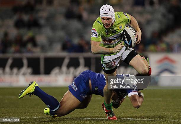 Jarrod Croker of the Raiders slips out of a tackle during the round 15 NRL match between the Canberra Raiders and the CanterburyBankstown Bulldogs at...
