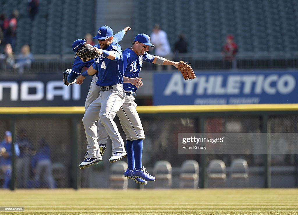 Jarrod Dyson #1 (L-R), <a gi-track='captionPersonalityLinkClicked' href=/galleries/search?phrase=Alex+Gordon+-+Baseball+Player&family=editorial&specificpeople=4494252 ng-click='$event.stopPropagation()'>Alex Gordon</a> #4 and <a gi-track='captionPersonalityLinkClicked' href=/galleries/search?phrase=Jeff+Francoeur&family=editorial&specificpeople=217574 ng-click='$event.stopPropagation()'>Jeff Francoeur</a> #21 of the Kansas City Royals celebrate their win over the Chicago White Sox on April 4, 2012 at U.S. Cellular Field in Chicago, Illinois. The Royals defeated the White Sox 3-1.