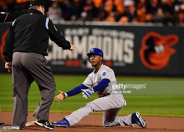Jarrod Dyson of the Kansas City Royals argues with Second Base Umpire Joe West after calling him out at second base by Jonathan Schoop of the...