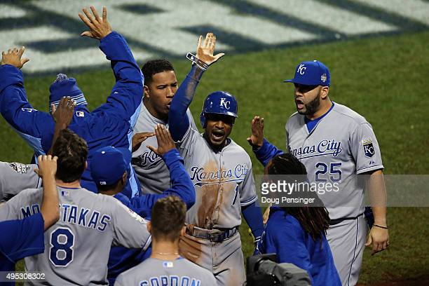 Jarrod Dyson of the Kansas City Royals celebrates after scoring the go ahead run hit by Christian Colon in the twelfth inning against Addison Reed of...