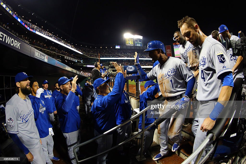<a gi-track='captionPersonalityLinkClicked' href=/galleries/search?phrase=Jarrod+Dyson&family=editorial&specificpeople=6780110 ng-click='$event.stopPropagation()'>Jarrod Dyson</a> #1 of the Kansas City Royals celebrates teammates after scoring the go ahead run hit by Christian Colon #24 in the twelfth inning against Addison Reed #43 of the New York Mets during Game Five of the 2015 World Series at Citi Field on November 1, 2015 in the Flushing neighborhood of the Queens borough of New York City.