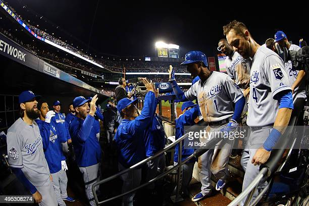 Jarrod Dyson of the Kansas City Royals celebrates teammates after scoring the go ahead run hit by Christian Colon in the twelfth inning against...