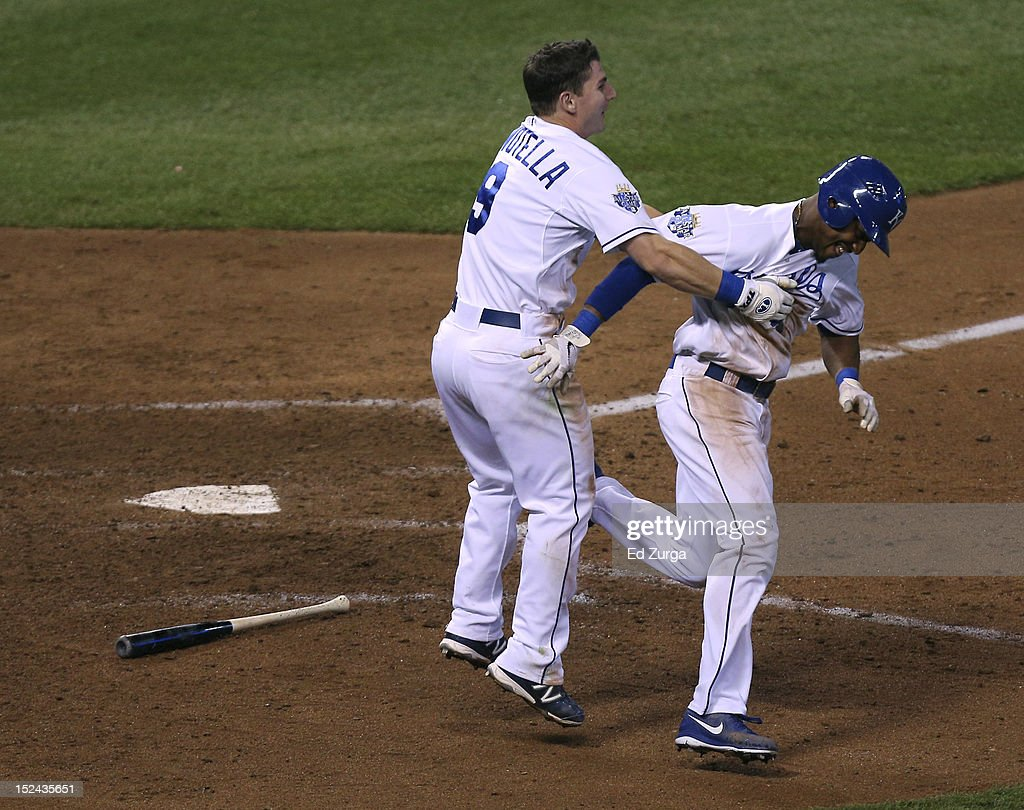 Jarrod Dyson #1 of the Kansas City Royals celebrates with <a gi-track='captionPersonalityLinkClicked' href=/galleries/search?phrase=Johnny+Giavotella&family=editorial&specificpeople=7512348 ng-click='$event.stopPropagation()'>Johnny Giavotella</a> #9 after scoring the game-winning run against the Chicago White Sox at Kauffman Stadium on September 20, 2012 in Kansas City, Missouri. The Royals won 4-3.