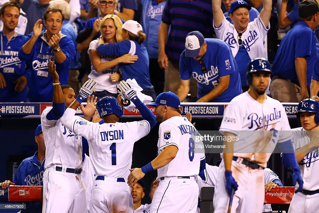 <a gi-track='captionPersonalityLinkClicked' href=/galleries/search?phrase=Jarrod+Dyson&family=editorial&specificpeople=6780110 ng-click='$event.stopPropagation()'>Jarrod Dyson</a> #1 of the Kansas City Royals celebrates with teammates after scoring on a sacrafice fly by Norichika Aoki #23 in the ninth inning to tie the Oakland Athletics during the American League Wild Card game at Kauffman Stadium on September 30, 2014 in Kansas City, Missouri.