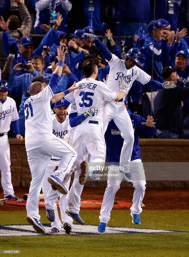 Jarrod Dyson #1 of the Kansas City Royals celebrates with teammates after defeating the New York Mets 5-4 in Game One of the 2015 World Series at Kauffman Stadium on October 27, 2015 in Kansas City, Missouri.