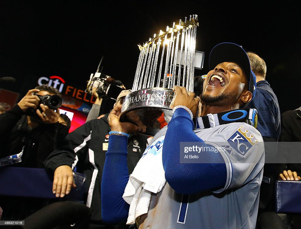 <a gi-track='captionPersonalityLinkClicked' href=/galleries/search?phrase=Jarrod+Dyson&family=editorial&specificpeople=6780110 ng-click='$event.stopPropagation()'>Jarrod Dyson</a> #1 of the Kansas City Royals celebrates with the Commissioner's Trophy after defeating the New York Mets to win Game Five of the 2015 World Series at Citi Field on November 1, 2015 in the Flushing neighborhood of the Queens borough of New York City. The Kansas City Royals defeated the New York Mets with a score of 7 to 2 to win the World Series.