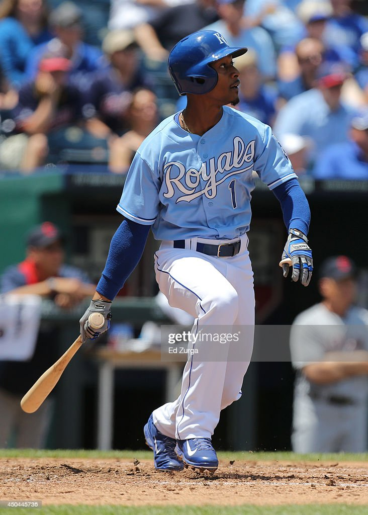 Jarrod Dyson #1 of the Kansas City Royals hits a sacrifice fly in the third inning against the Cleveland Indians at Kauffman Stadium on June 11, 2014 in Kansas City, Missouri.