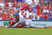 Jarrod Dyson of the Kansas City Royals is caught stealing third base by Greg Garcia of the St Louis Cardinals in the second inning at Busch Stadium...
