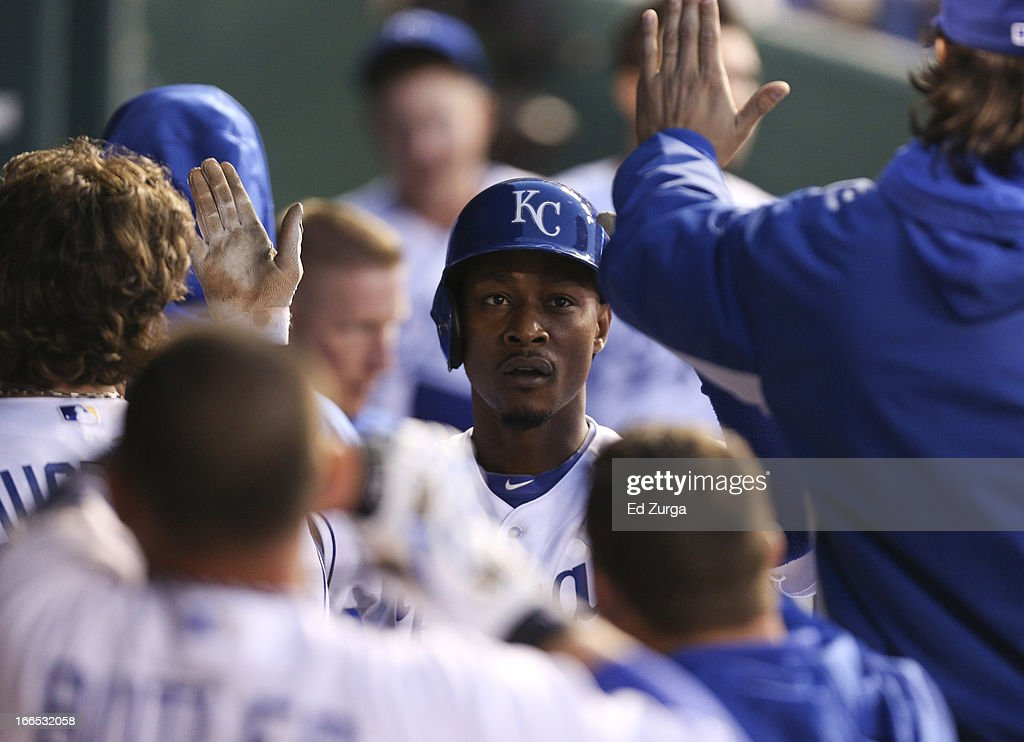 Jarrod Dyson #1 of the Kansas City Royals is congratulated by teammates after scoring on a Chris Getz bunt against the Toronto Blue Jays in the seventh inning at Kauffman Stadium April 13, 2013 in Kansas City, Missouri.