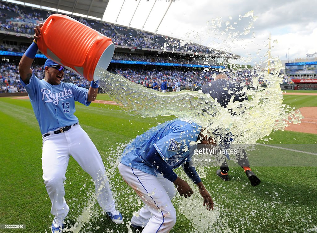 <a gi-track='captionPersonalityLinkClicked' href=/galleries/search?phrase=Jarrod+Dyson&family=editorial&specificpeople=6780110 ng-click='$event.stopPropagation()'>Jarrod Dyson</a> #1 of the Kansas City Royals is doused with water by Salvador Perez #13 as they celebrate a 3-2 win over the Boston Red Sox during the first game of a doubleheader at Kauffman Stadium on May 18, 2016 in Kansas City, Missouri.