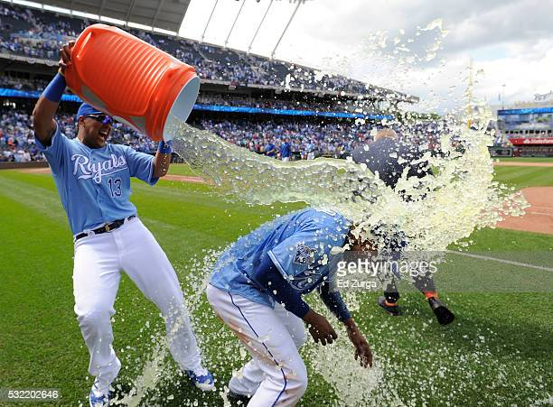 Jarrod Dyson of the Kansas City Royals is doused with water by Salvador Perez as they celebrate a 32 win over the Boston Red Sox during the first...