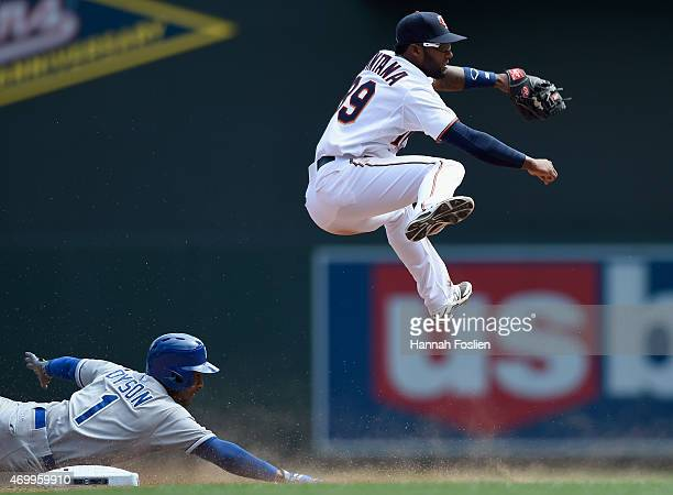 Jarrod Dyson of the Kansas City Royals is out at second base as he breaks up a double play attempt by Danny Santana of the Minnesota Twins during the...