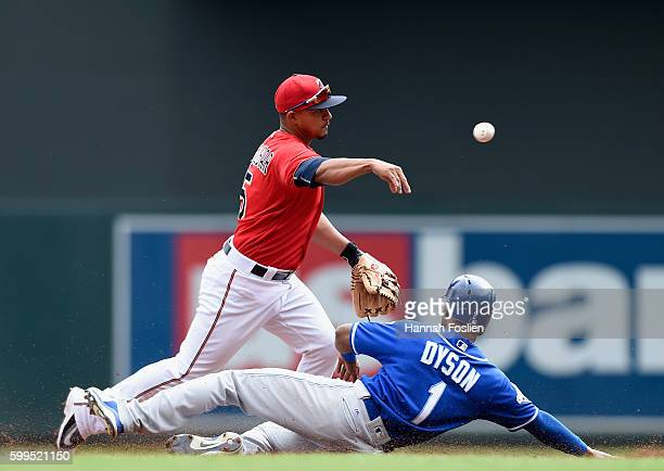 Jarrod Dyson of the Kansas City Royals is out at second base as Eduardo Escobar of the Minnesota Twins turns a double play during the first inning of...