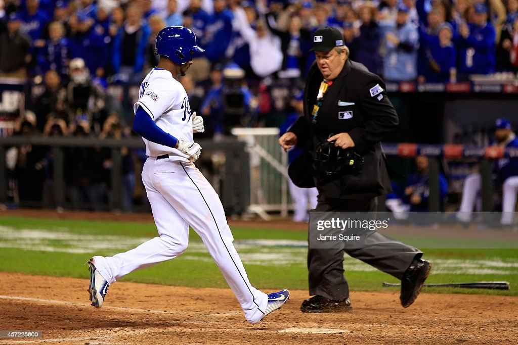 <a gi-track='captionPersonalityLinkClicked' href=/galleries/search?phrase=Jarrod+Dyson&family=editorial&specificpeople=6780110 ng-click='$event.stopPropagation()'>Jarrod Dyson</a> #1 of the Kansas City Royals scores on Billy Butler #16 of the Kansas City Royals sacrifice fly to left field in the sixth inning to take the lead against Kevin Gausman #39 of the Baltimore Orioles during Game Three of the American League Championship Series at Kauffman Stadium on October 14, 2014 in Kansas City, Missouri.