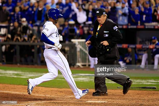 Jarrod Dyson of the Kansas City Royals scores on Billy Butler of the Kansas City Royals sacrifice fly to left field in the sixth inning to take the...