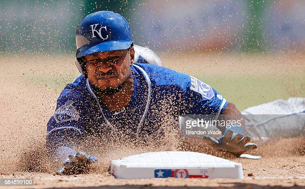 Jarrod Dyson of the Kansas City Royals steals third during the fifth inning of a baseball game against the Texas Rangers at Globe Life Park on Sunday...
