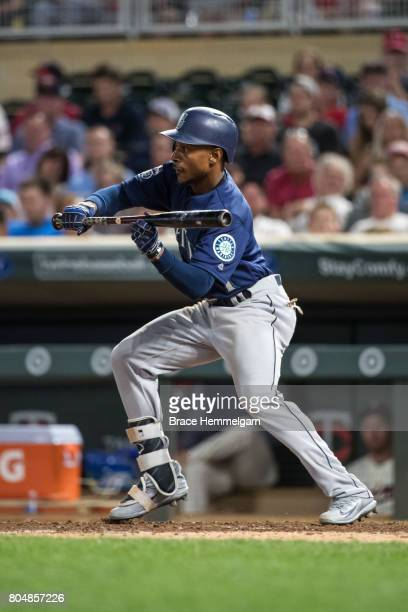Jarrod Dyson of the Seattle Mariners bunts against the Minnesota Twins on June 14 2017 at Target Field in Minneapolis Minnesota The Mariners defeated...