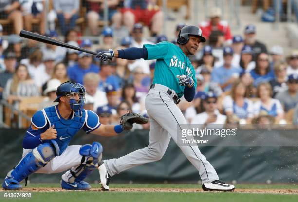 Jarrod Dyson of the Seattle Mariners grounds out in the third inning against the Los Angeles Dodgers during the spring training game at Camelback...