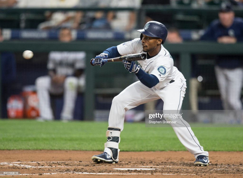 Jarrod Dyson #1 of the Seattle Mariners lays down a sacrifice bunt off of starting pitcher Wade Miley #38 of the Baltimore Orioles and reached on a fielder's choice during the fifth inning of a game at Safeco Field on August 15, 2017 in Seattle, Washington.