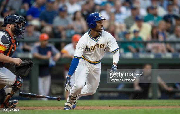 Jarrod Dyson of the Seattle Mariners runs to first after putting the ball in play during a game against the Houston Astros at Safeco Field on June 24...