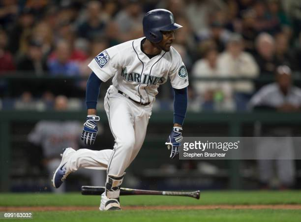 Jarrod Dyson of the Seattle Mariners runs to first base after laying down a bunt during a game against the Detroit Tigers at Safeco Field on June 19...
