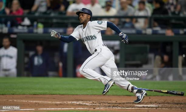 Jarrod Dyson of the Seattle Mariners runs to first base after laying down a bunt during a game against the Baltimore Orioles at Safeco Field on...