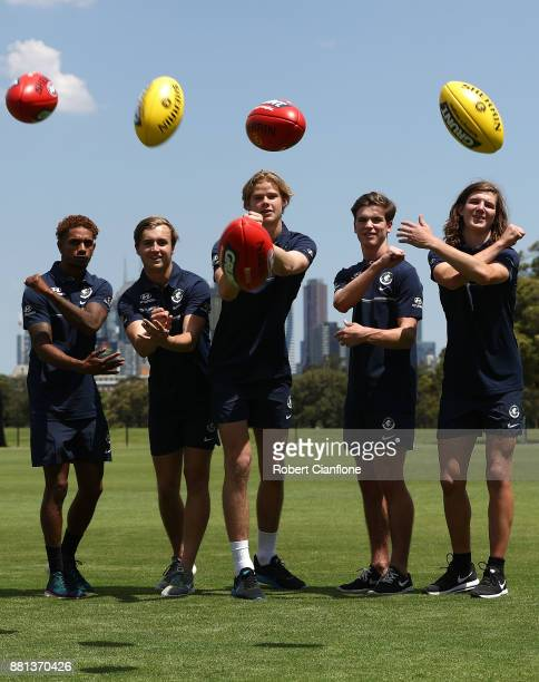 Jarrod Garlett Lochie O'Brien Tom De Koning Paddy Dow and Angus Schumacher pose during a Carlton Blues AFL media opportunity at Princes Park on...
