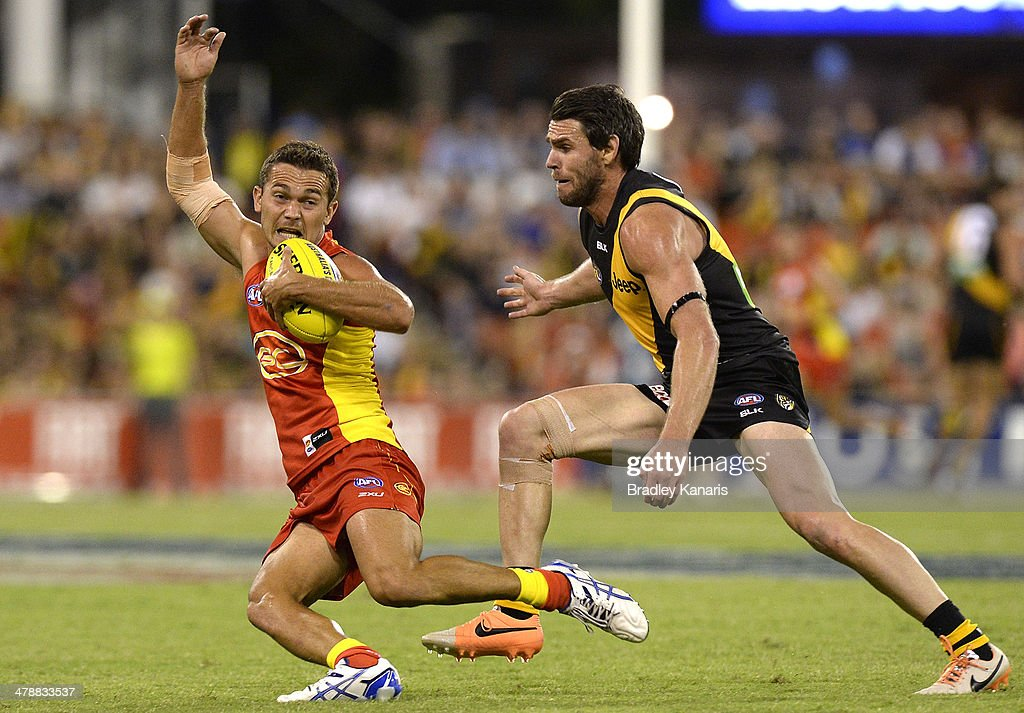 <a gi-track='captionPersonalityLinkClicked' href=/galleries/search?phrase=Jarrod+Harbrow&family=editorial&specificpeople=779160 ng-click='$event.stopPropagation()'>Jarrod Harbrow</a> of the Suns breaks away from the defence during the round one AFL match between the Gold Coast Suns and the Richmond Tigers at Metricon Stadium on March 15, 2014 in Gold Coast, Australia.