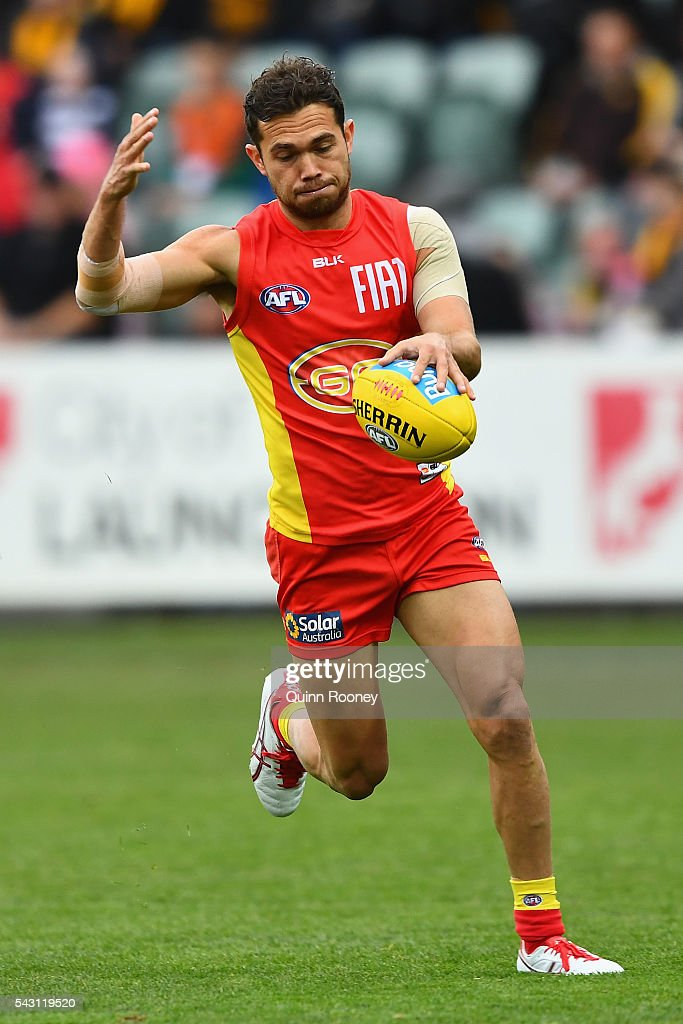 <a gi-track='captionPersonalityLinkClicked' href=/galleries/search?phrase=Jarrod+Harbrow&family=editorial&specificpeople=779160 ng-click='$event.stopPropagation()'>Jarrod Harbrow</a> of the Suns kicks during the round 14 AFL match between the Hawthorn Hawks and the Gold Coast Suns at Aurora Stadium on June 26, 2016 in Launceston, Australia.
