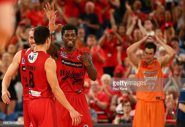 Jarrod Kenny and Casey Prather of the Wildcats celebrate after winning the round seven NBL match between the Perth Wildcats and the Cairns Taipans at...