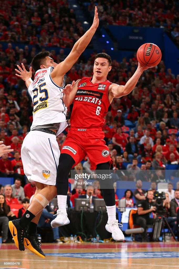 Jarrod Kenny of the Wildcats passes the ball aaginst Reuben TeRangi of the Bullets during the round one NBL match between the Perth Wildcats and the Brisbane Bullets at Perth Arena on October 7, 2017 in Perth, Australia.