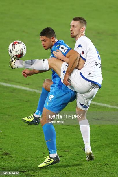 Jarrod Kyle of Gold Coast City and Luke Adams of South Melbourne compete for the ball during the FFA Cup Quarter Final match between Gold Coast City...