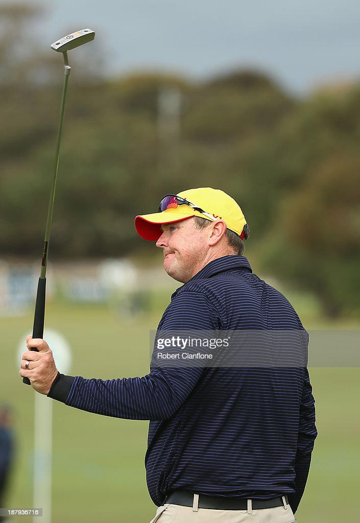 <a gi-track='captionPersonalityLinkClicked' href=/galleries/search?phrase=Jarrod+Lyle&family=editorial&specificpeople=210982 ng-click='$event.stopPropagation()'>Jarrod Lyle</a> of Australia acknowledges the crowd after playing round one of the 2013 Australian Masters at Royal Melbourne Golf Course on November 14, 2013 in Melbourne, Australia.