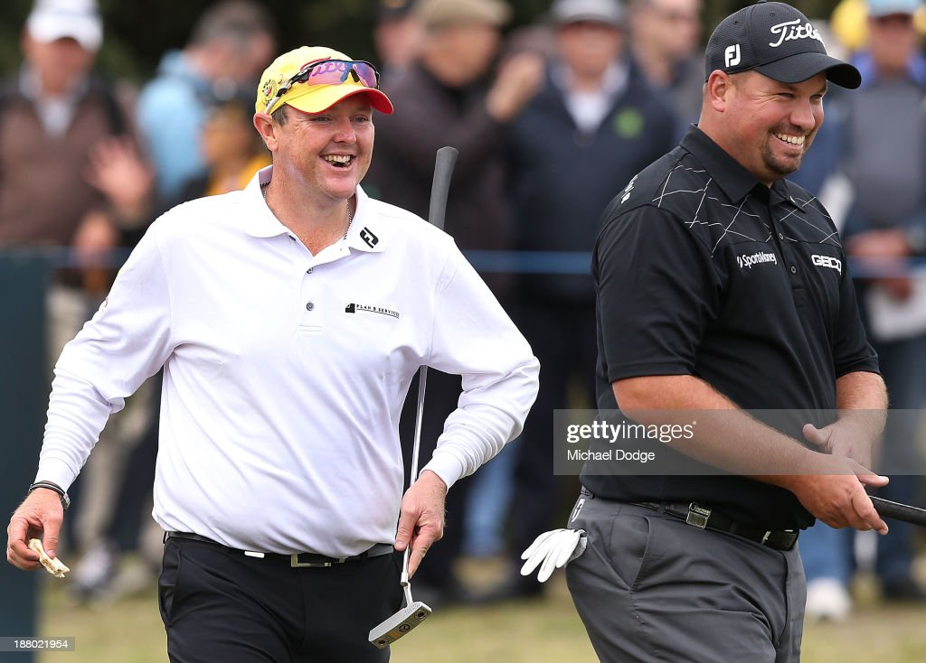<a gi-track='captionPersonalityLinkClicked' href=/galleries/search?phrase=Jarrod+Lyle&family=editorial&specificpeople=210982 ng-click='$event.stopPropagation()'>Jarrod Lyle</a> (L) of Australia and Brendon De Jonge of Zimbabwe react during round two of the 2013 Australian Masters at Royal Melbourne Golf Course on November 15, 2013 in Melbourne, Australia.