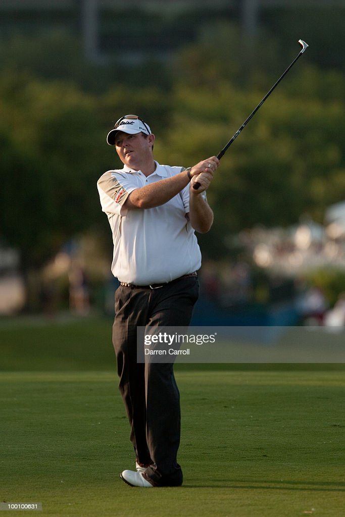 Jarrod Lyle of Australia follows through on an approach shot during the first round of the HP Byron Nelson Championship at TPC Four Seasons Resort Las Colinas on May 20, 2010 in Irving, Texas.