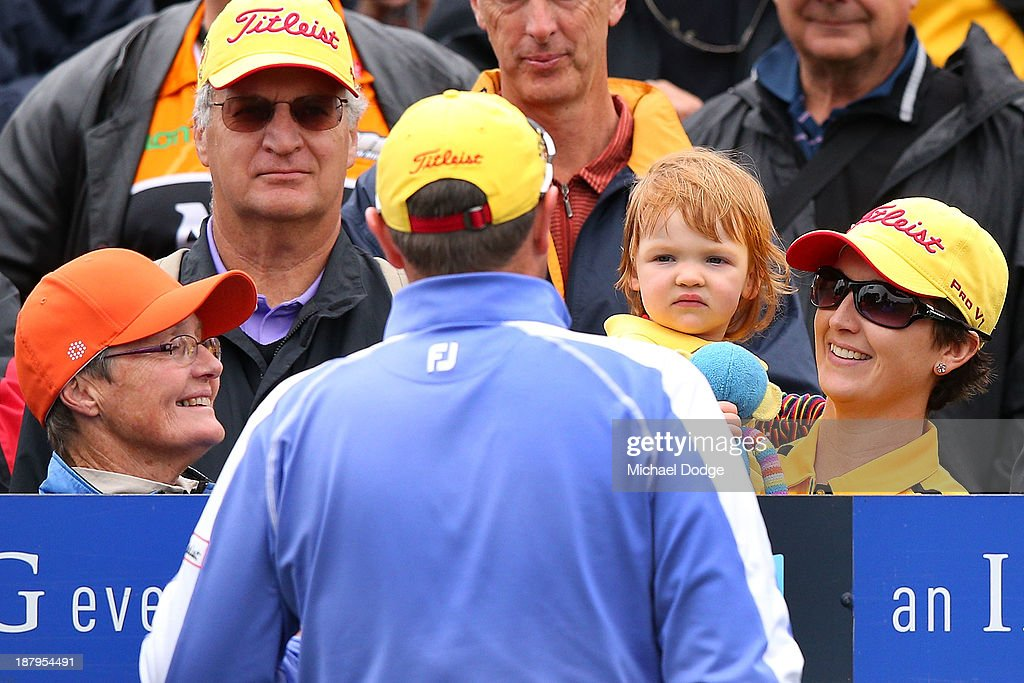 Jarrod Lyle of Australia greeted by his daughter Lusi Lyle and wife Briony Lyle before his shot on the first tee during round one of the 2013 Australian Masters at Royal Melbourne Golf Course on November 14, 2013 in Melbourne, Australia.