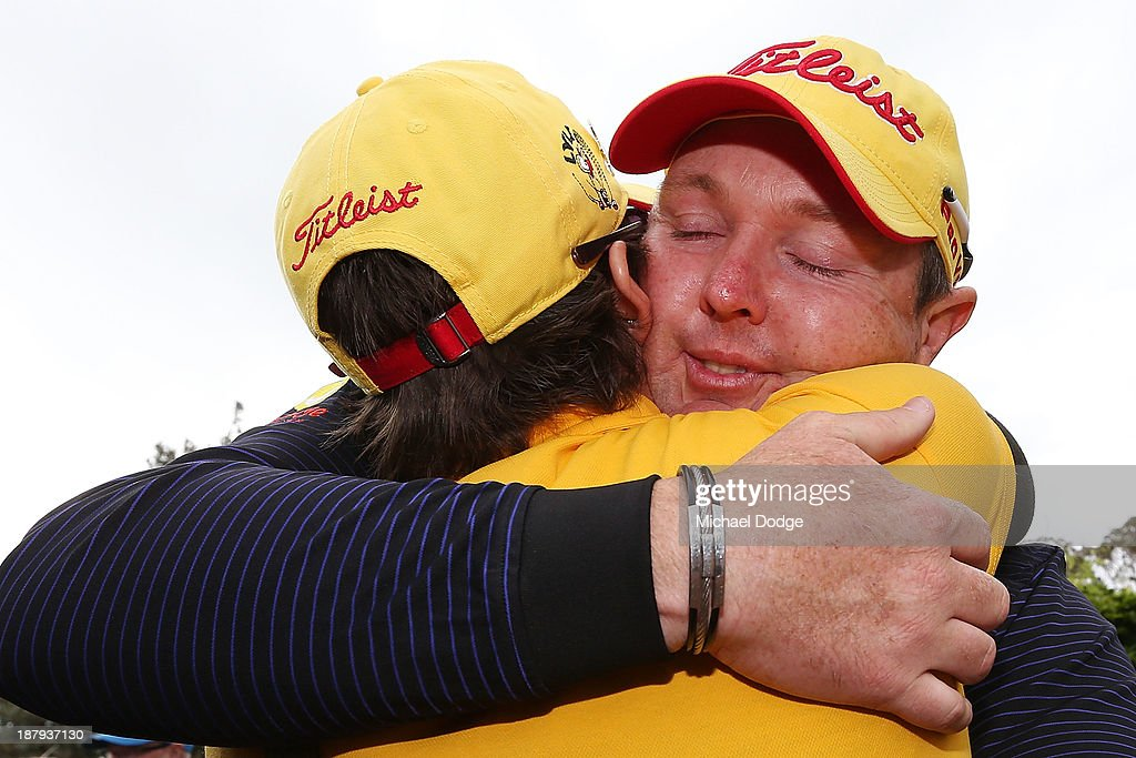 Jarrod Lyle of Australia hugs wife Briony Lyle after the 18th hole during round one of the 2013 Australian Masters at Royal Melbourne Golf Course on November 14, 2013 in Melbourne, Australia.