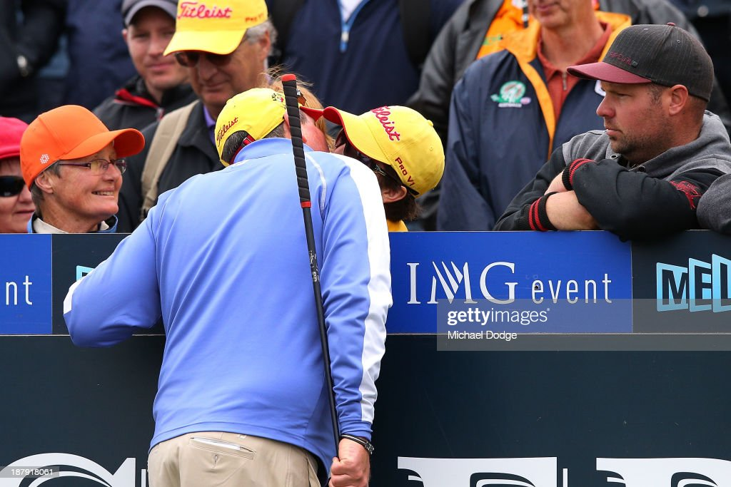 <a gi-track='captionPersonalityLinkClicked' href=/galleries/search?phrase=Jarrod+Lyle&family=editorial&specificpeople=210982 ng-click='$event.stopPropagation()'>Jarrod Lyle</a> of Australia kisses his wife Brioni Lyle on the first tee before his shot during round one of the 2013 Australian Masters at Royal Melbourne Golf Course on November 14, 2013 in Melbourne, Australia.