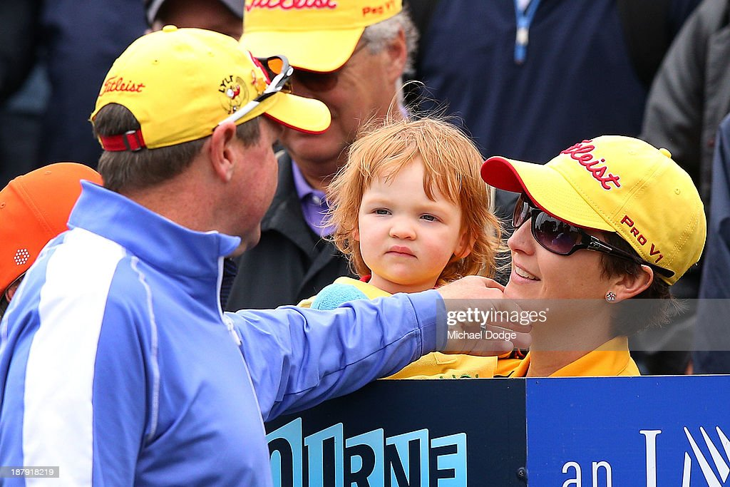 <a gi-track='captionPersonalityLinkClicked' href=/galleries/search?phrase=Jarrod+Lyle&family=editorial&specificpeople=210982 ng-click='$event.stopPropagation()'>Jarrod Lyle</a> of Australia touches his wife Briony Lyle on the chin who holds his daughter Lusi Lyle on the first tee before his shot during round one of the 2013 Australian Masters at Royal Melbourne Golf Course on November 14, 2013 in Melbourne, Australia.