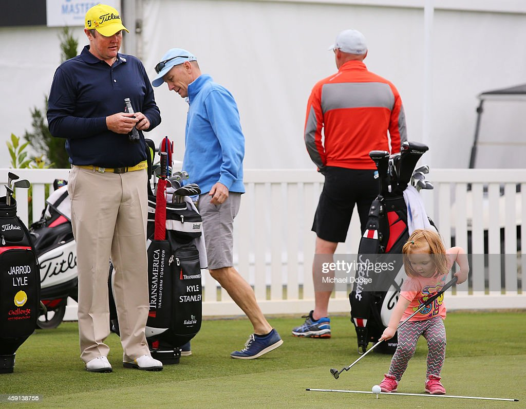Jarrod Lyle of Australia watches daughter Lucy Lyle putt on the practice green ahead of the 2014 Australian Masters at The Metropolitan Golf Course on November 18, 2014 in Melbourne, Australia.