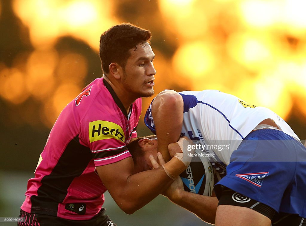 Jarrod McInally of the Bulldogs is tackled by Dallin Watene-Zelezniak of the Panthers during the NRL Trial match between the Canterbury Bulldogs and the Penrith Panthers at Pepper Stadium on February 13, 2016 in Sydney, Australia.